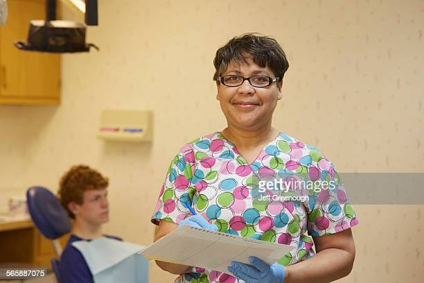 Pediatric dentist smiling in office