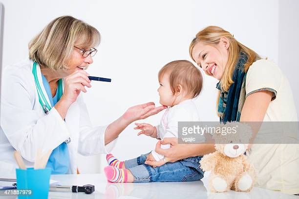 Pediatrician Checking Eyesight of an baby girl.