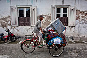 A pedicab driver carries ballot boxes for distribution to polling stations during preparations for the Legislative Election on April 8 2014 in...