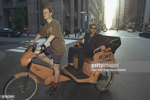 Pedicab driver David Silva with passenger outside Grand Central Terminal The taxi strike made business pretty good for the alternative cab