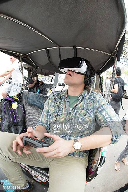 A pedicab passenger particpates in a Samsung virtual reality experience during SXSW on March 13 2016 in Austin Texas