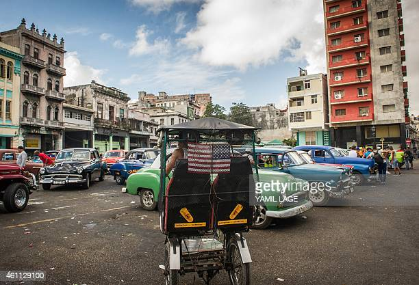 A pedicab with a national flag of the United States is seen in Havana on January 7 2015 Last month the United States announced that it would end...