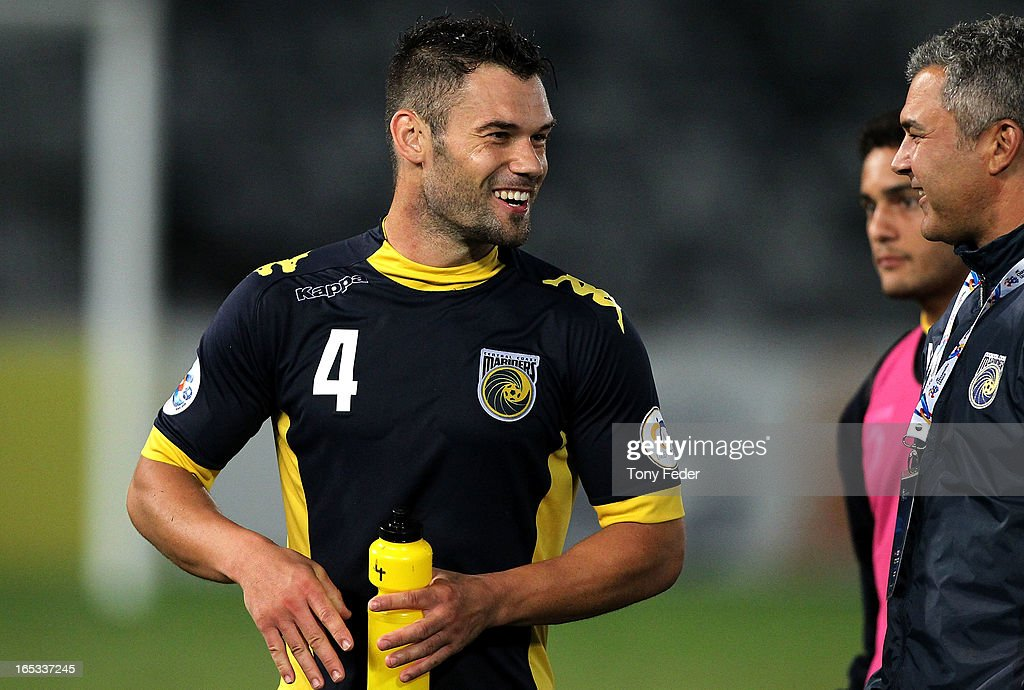 Pedj Bojic celebrates the win with team officials during the AFC Asian Champions League match between the Central Coast Mariners and Guizhou at Bluetongue Stadium on April 3, 2013 in Gosford, Australia.