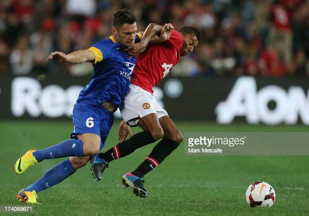 Pedj Bojic of the AllStars and Anders Lindegaard of Manchester United compete for the ball during the match between the ALeague AllStars and...