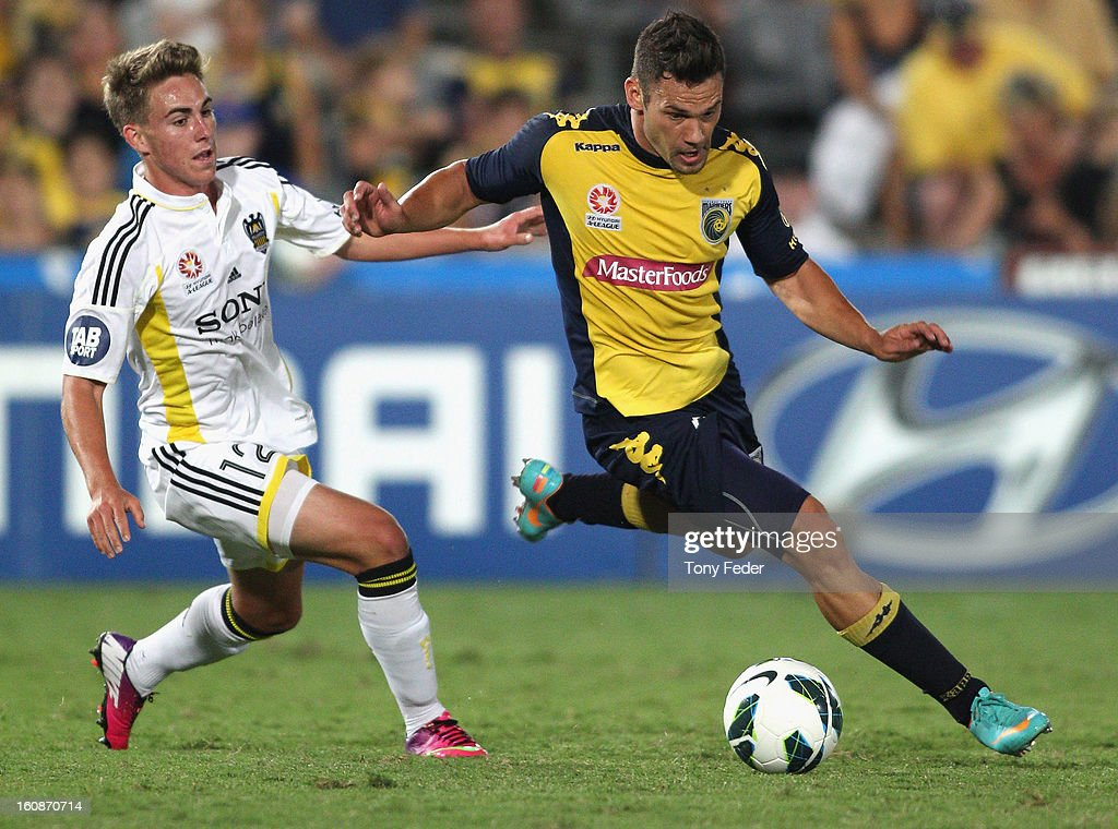 Pedj Bojic of the Mariners and Tyler Boyd of the Phoenix contest the ball during the round 20 A-League match between the Central Coast Mariners and the Wellington Phoenix at Bluetongue Stadium on February 7, 2013 in Gosford, Australia.