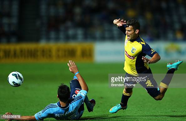 Pedj Bojic of the Mariners competes with Daniel Petkovski of Sydney during the round five ALeague match between the Central Coast Mariners and Sydney...