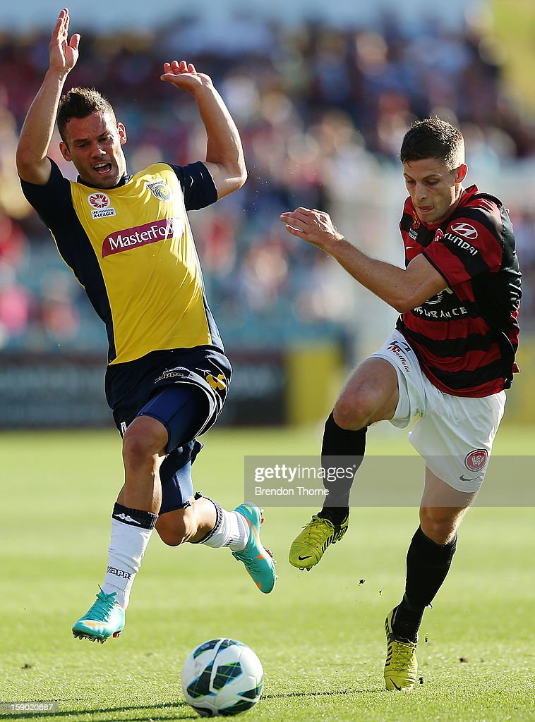 Pedj Bojic of the Mariners competes with Shannon Cole of the Wanderers during the round 15 A-League match between the Western Sydney Wanderers and the Central Coast Mariners at Parramatta Stadium on January 6, 2013 in Sydney, Australia.