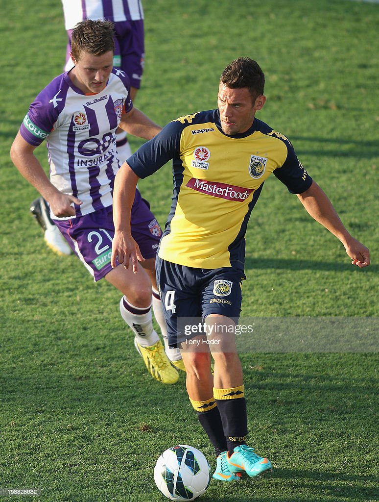 Pedj Bojic of the Mariners controls the ball in front of Scott Jamieson of the Glory during the round 14 A-League match between the Central Coast Mariners and the Perth Glory at Bluetongue Stadium on December 31, 2012 in Gosford, Australia.
