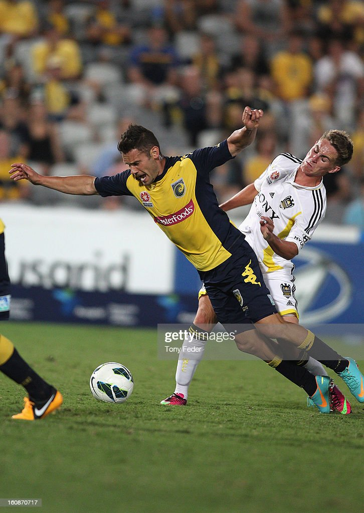 Pedj Bojic of the Mariners is fouled by Tyler Boyd of the Phoenix during the round 20 A-League match between the Central Coast Mariners and the Wellington Phoenix at Bluetongue Stadium on February 7, 2013 in Gosford, Australia.