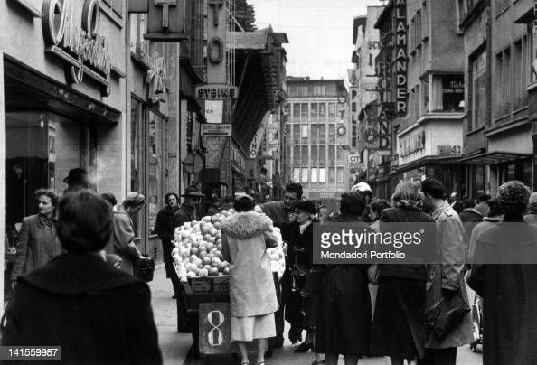 Pedlar selling fruit in a city centre street Cologne March 1956