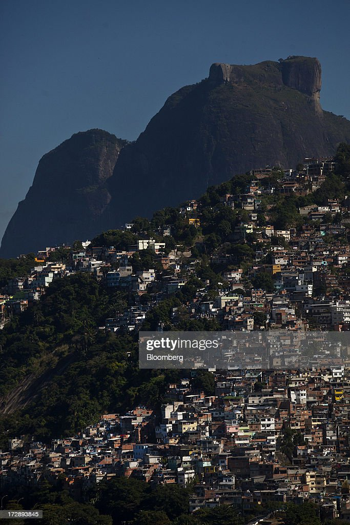 Pedra da Gavea Mountain stands over the Vidigal slum in this aerial photograph of Rio de Janeiro, Brazil, on Thursday, July 4, 2013. Brazils shorter-term swap rates fell after a report showed inflation slowed in June more than analysts forecast, damping speculation that the central bank will increase borrowing costs at a faster pace. Photographer: Dado Galdieri/Bloomberg via Getty Images