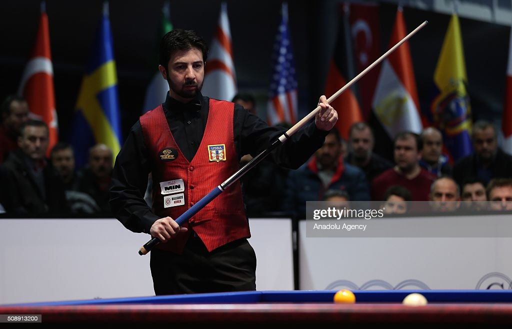 Pedra Piedrabuena of USA competes against Dick Jaspers (not seen) of Netherlands during 2nd match of semi-final of the Carom Billiards 3 Cushion World Cup in Bursa, Turkey on February 7, 2016.