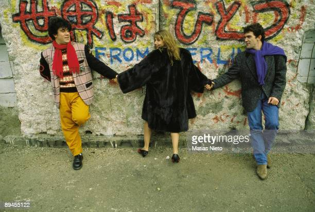 Pedro Almodovar Victoria Abril and Antonio Banderas beside the Berlin Wall The director and the actors on the wall during the presentation of 'Tie me...