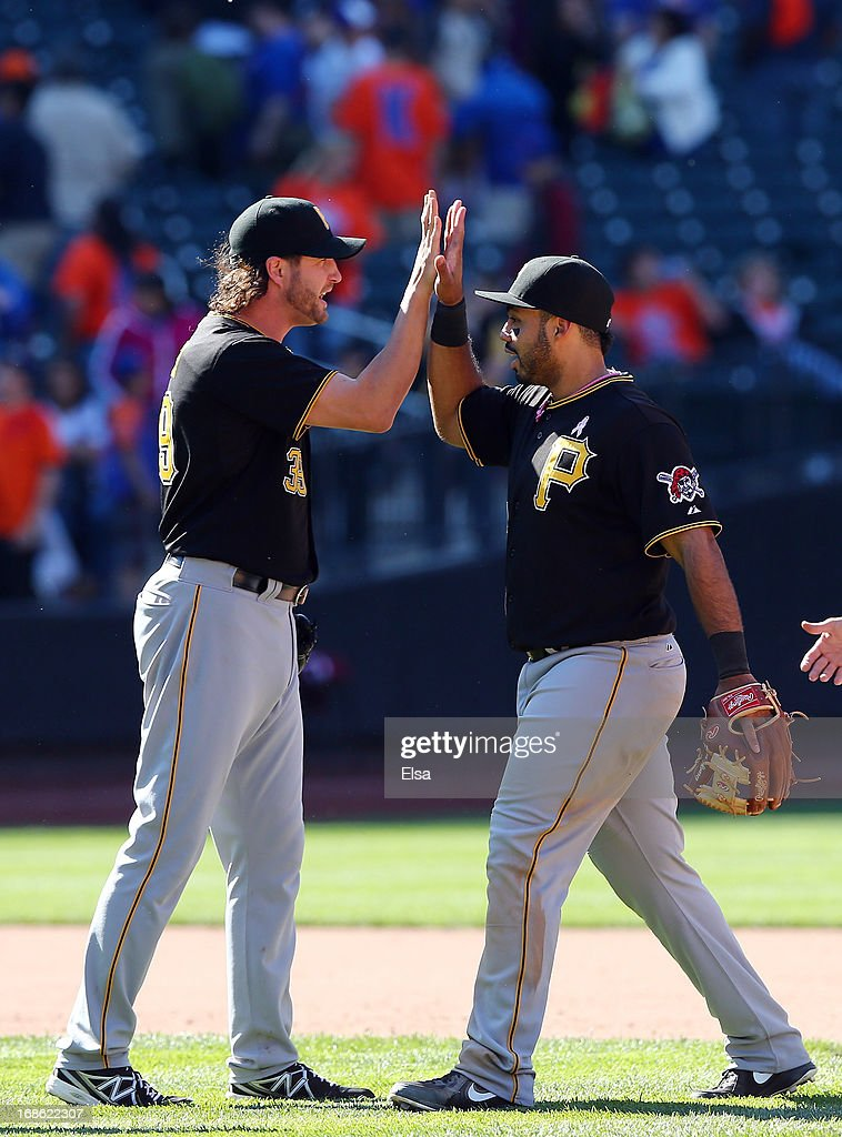 Pedro Alvarez #24 and <a gi-track='captionPersonalityLinkClicked' href=/galleries/search?phrase=Jason+Grilli&family=editorial&specificpeople=615724 ng-click='$event.stopPropagation()'>Jason Grilli</a> #39 of the Pittsburgh Pirates celebrate the win over the New York Mets on May 12, 2013 at Citi Field in the Flushing neighborhood of the Queens borough of New York City. The Pittsburgh Pirates defeated the New York Mets 3-2.