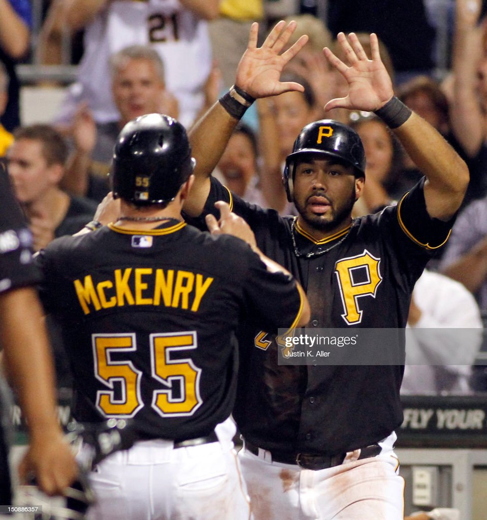 Pedro Alvarez #24 and Michael McKenry #55 of the Pittsburgh Pirates celebrate after scoring on a two-RBI single in the fifth inning against the St. Louis Cardinals during the game on August 28, 2012 at PNC Park in Pittsburgh, Pennsylvania.