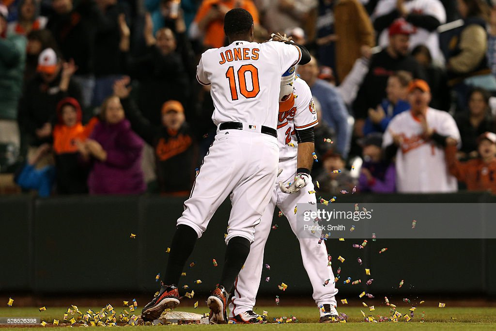 Pedro Alvarez #24 of the Baltimore Orioles has bubble gum dumped on his by teammate <a gi-track='captionPersonalityLinkClicked' href=/galleries/search?phrase=Adam+Jones+-+Jogador+de+beisebol&family=editorial&specificpeople=5460465 ng-click='$event.stopPropagation()'>Adam Jones</a> #10 after hitting a sacrifice RBI against the New York Yankees in the tenth inning at Oriole Park at Camden Yards on May 5, 2016 in Baltimore, Maryland. The Baltimore Orioles won, 1-0, in the tenth inning.