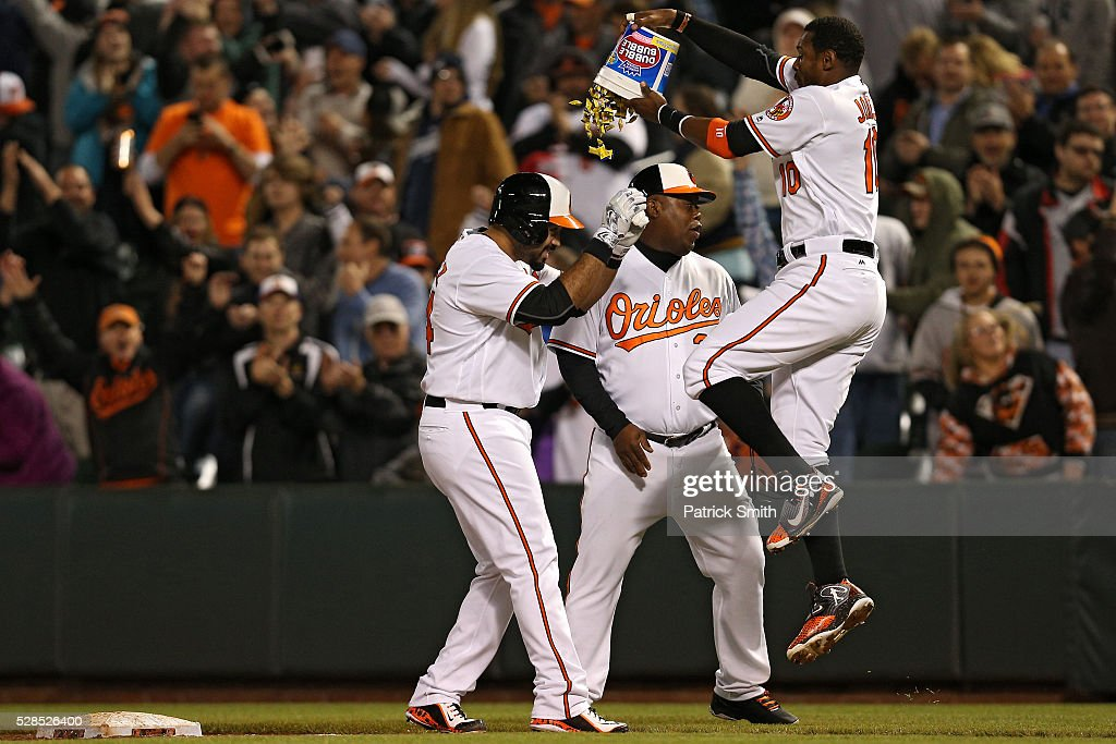 Pedro Alvarez #24 of the Baltimore Orioles has bubble gum dumped on his by teammate <a gi-track='captionPersonalityLinkClicked' href=/galleries/search?phrase=Adam+Jones+-+Baseball&family=editorial&specificpeople=5460465 ng-click='$event.stopPropagation()'>Adam Jones</a> #10 after hitting a sacrifice RBI against the New York Yankees in the tenth inning at Oriole Park at Camden Yards on May 5, 2016 in Baltimore, Maryland. The Baltimore Orioles won, 1-0, in the tenth inning.