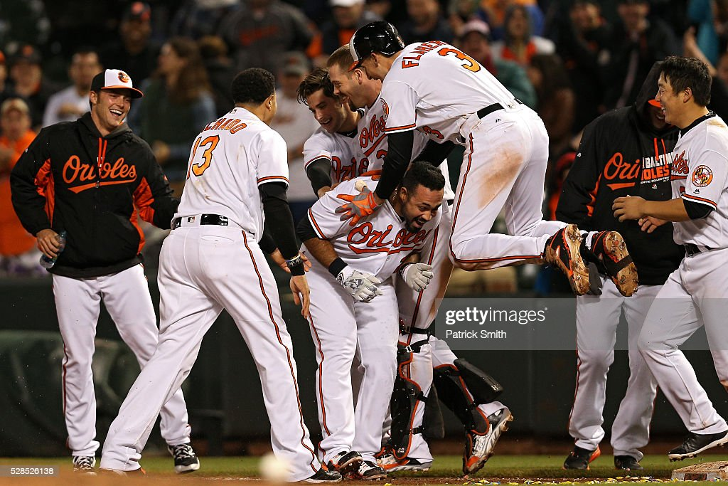 Pedro Alvarez #24 of the Baltimore Orioles is mobbed by <a gi-track='captionPersonalityLinkClicked' href=/galleries/search?phrase=Ryan+Flaherty&family=editorial&specificpeople=4412528 ng-click='$event.stopPropagation()'>Ryan Flaherty</a> #3 and teammates after hitting the sacrifice RBI against the New York Yankees in the tenth inning at Oriole Park at Camden Yards on May 5, 2016 in Baltimore, Maryland. The Baltimore Orioles won, 1-0, in the tenth inning.