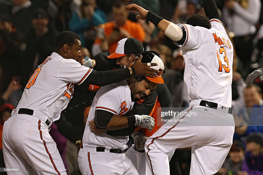 Pedro Alvarez #24 of the Baltimore Orioles is mobbed teammates after hitting a sacrifice RBI against the New York Yankees in the tenth inning at Oriole Park at Camden Yards on May 5, 2016 in Baltimore, Maryland. The Baltimore Orioles won, 1-0, in the tenth inning.