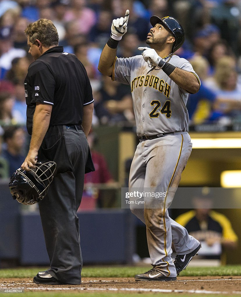 Pedro Alvarez #24 of the Pittsburg Pirates crosses home plate after hitting a three-run homer off of Wiley Peralta #38 of the Milwaukee Brewers at Miller Park on August 23, 2014 in Milwaukee, Wisconsin.