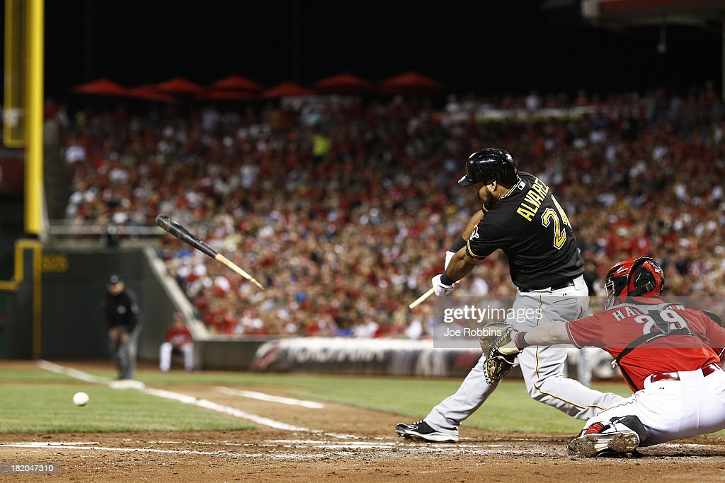 Pedro Alvarez #24 of the Pittsburgh Pirates breaks his bat as he grounds into a double play in the third inning against the Cincinnati Reds during the game at Great American Ball Park on September 27, 2013 in Cincinnati, Ohio.