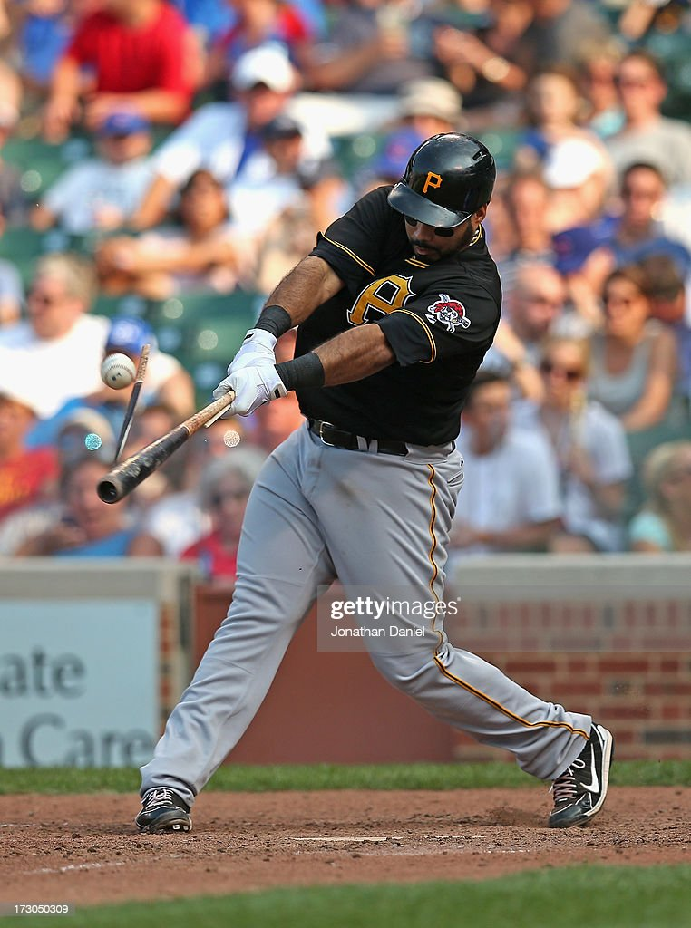 Pedro Alvarez #24 of the Pittsburgh Pirates breaks his bat hitting a sinle in the 8th inning against the Chicago Cubs at Wrigley Field on July 5, 2013 in Chicago, Illinois. The Pirates defeated the Cubs 6-2.