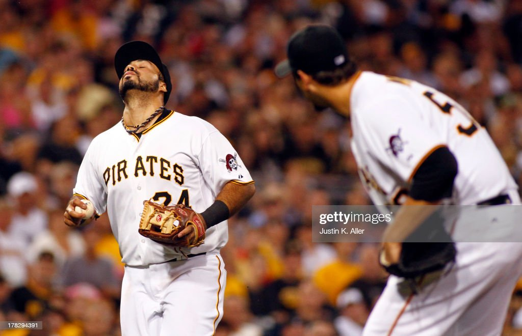 Pedro Alvarez #24 of the Pittsburgh Pirates can't make the throw over the pitcher in the fourth inning against the Milwaukee Brewers during the game on August 28, 2013 at PNC Park in Pittsburgh, Pennsylvania.