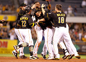 Pedro Alvarez of the Pittsburgh Pirates celebrates his walk off single with teammates in the ninth inning against the San Diego Padres during the...