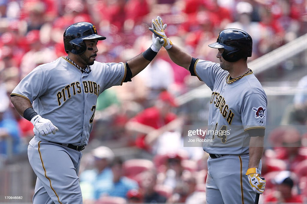 Pedro Alvarez #24 of the Pittsburgh Pirates celebrates with <a gi-track='captionPersonalityLinkClicked' href=/galleries/search?phrase=Gaby+Sanchez&family=editorial&specificpeople=4945789 ng-click='$event.stopPropagation()'>Gaby Sanchez</a> #14 after hitting a home run in the sixth inning against the Cincinnati Reds during the game at Great American Ball Park on June 20, 2013 in Cincinnati, Ohio. The Pirates won 5-3.