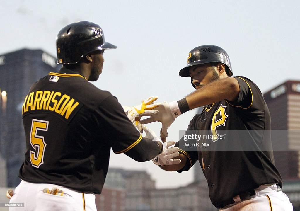 Pedro Alvarez #24 of the Pittsburgh Pirates celebrates with Josh Harrison #5 after hitting a two-run home run in the third inning against the St. Louis Cardinals during the game on August 28, 2012 at PNC Park in Pittsburgh, Pennsylvania.