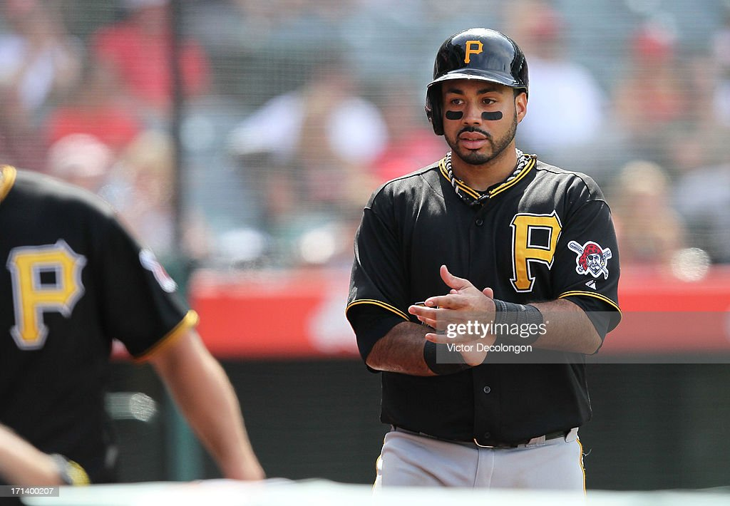 Pedro Alvarez #24 of the Pittsburgh Pirates claps his hands as he walks to the dugout after scoring on a single to left field by Travis Snider #23 (not in photo) in the tenth inning during the MLB game against the Los Angeles Angels of Anaheim at Angel Stadium of Anaheim on June 23, 2013 in Anaheim, California. The Pirates defeated the Angels 10-9 in ten innings.