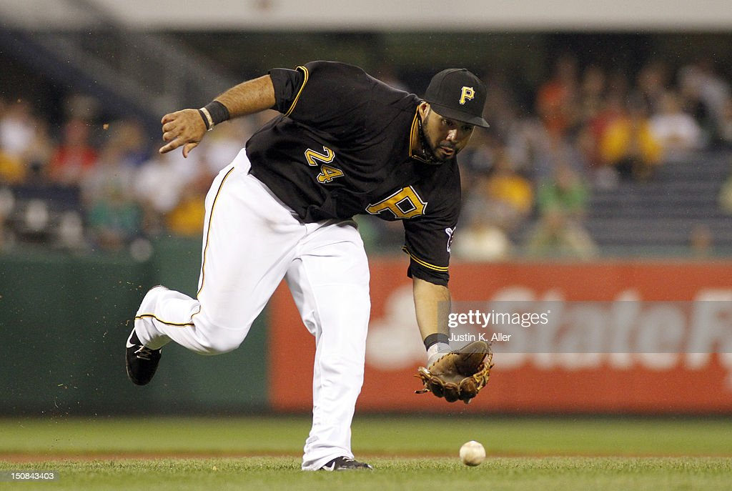 Pedro Alvarez #24 of the Pittsburgh Pirates fields a ground ball against the St. Louis Cardinals during the game on August 27, 2012 at PNC Park in Pittsburgh, Pennsylvania.
