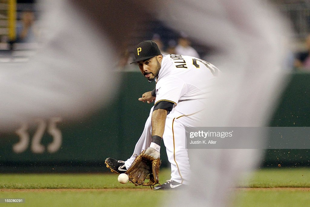 Pedro Alvarez #24 of the Pittsburgh Pirates fields a ground ball against the Atlanta Braves during the game on October 2, 2012 at PNC Park in Pittsburgh, Pennsylvania.