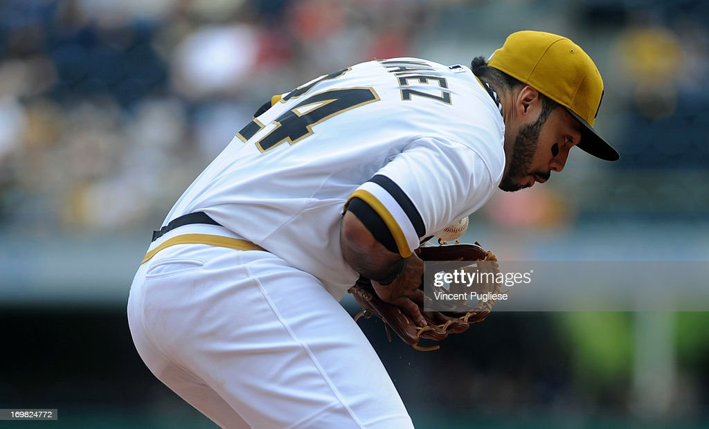Pedro Alvarez #24 of the Pittsburgh Pirates fields a ground ball against the Cincinnati Reds at PNC Park on June 2, 2013 in Pittsburgh, Pennsylvania.