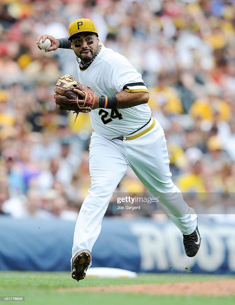 Pedro Alvarez #24 of the Pittsburgh Pirates fields a ground ball during the fourth inning against the Philadelphia Phillies on July 6, 2014 at PNC Park in Pittsburgh, Pennsylvania. Pittsburgh won the game 6-2.