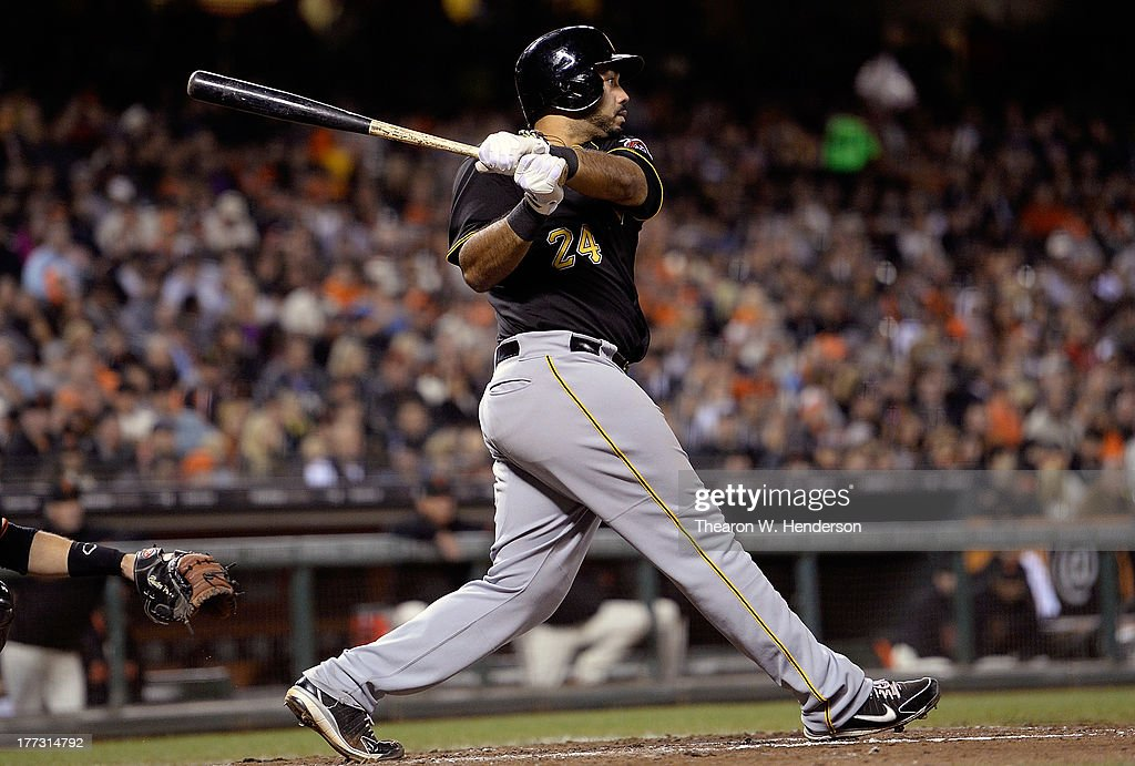 Pedro Alvarez #24 of the Pittsburgh Pirates hits a bases-loaded, two-run double in the fifth inning against the San Francisco Giants at AT&T Park on August 22, 2013 in San Francisco, California.