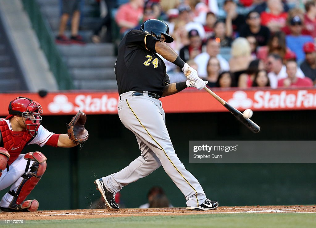 Pedro Alvarez #24 of the Pittsburgh Pirates hits a solo home run in the second inning against the Los Angeles Angels of Anaheim at Angel Stadium of Anaheim on June 22, 2013 in Anaheim, California.