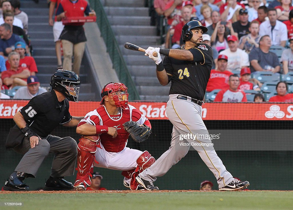 Pedro Alvarez #24 of the Pittsburgh Pirates hits a solo homerun to right field in the second inning during the MLB game against the Los Angeles Angels of Anaheim at Angel Stadium of Anaheim on June 21, 2013 in Anaheim, California. The Pirates defeated the Angels 5-2.