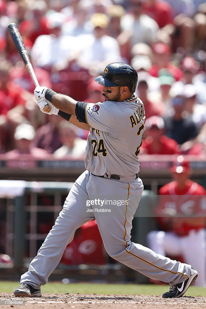 Pedro Alvarez #24 of the Pittsburgh Pirates hits a three-run double to break a tie game in the seventh inning against the Cincinnati Reds at Great American Ball Park on June 20, 2013 in Cincinnati, Ohio. The Pirates won 5-3.