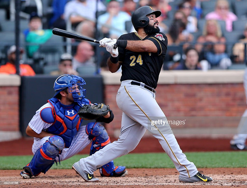 Pedro Alvarez #24 of the Pittsburgh Pirates hits an RBI single as Travis d'Arnaud #7 of the New York Mets defends in the seventh inning on August 16, 2015 at Citi Field in the Flushing neighborhood of the Queens borough of New York City.The Pittsburgh Pirates defeated the New York Mets 8-1.