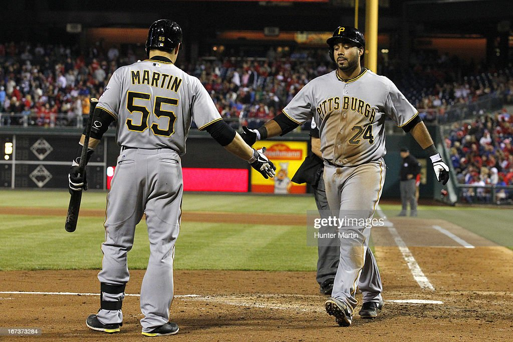 Pedro Alvarez #24 of the Pittsburgh Pirates is congratulated by <a gi-track='captionPersonalityLinkClicked' href=/galleries/search?phrase=Russell+Martin+-+Baseball+Player&family=editorial&specificpeople=13764024 ng-click='$event.stopPropagation()'>Russell Martin</a> #55 after hitting a solo home run in the seventh inning during a game against the Philadelphia Phillies at Citizens Bank Park on April 24, 2013 in Philadelphia, Pennsylvania. The Pirates won 5-3.