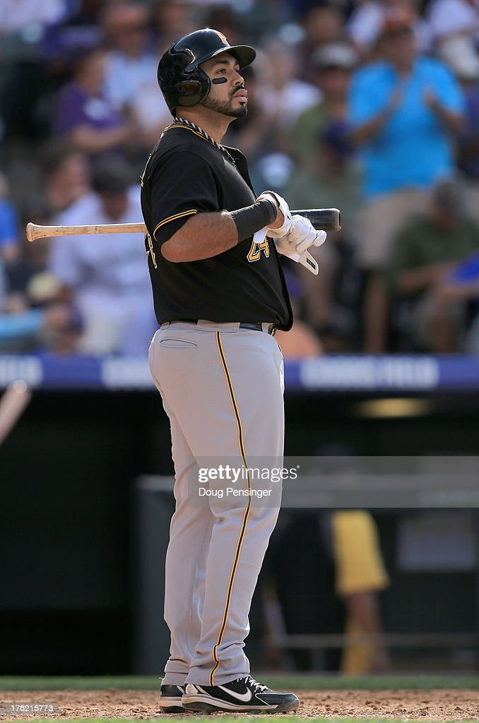 Pedro Alvarez #24 of the Pittsburgh Pirates looks on after striking out against the Colorado Rockies at Coors Field on August 11, 2013 in Denver, Colorado. The Rockies defeated the Pirates 3-2 and swept the three game series.