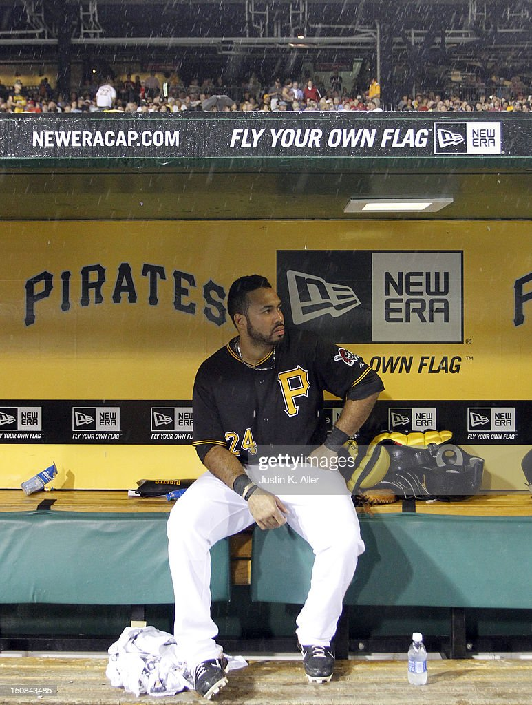 Pedro Alvarez #24 of the Pittsburgh Pirates looks on during a rain delay against the St. Louis Cardinals during the game on August 27, 2012 at PNC Park in Pittsburgh, Pennsylvania.