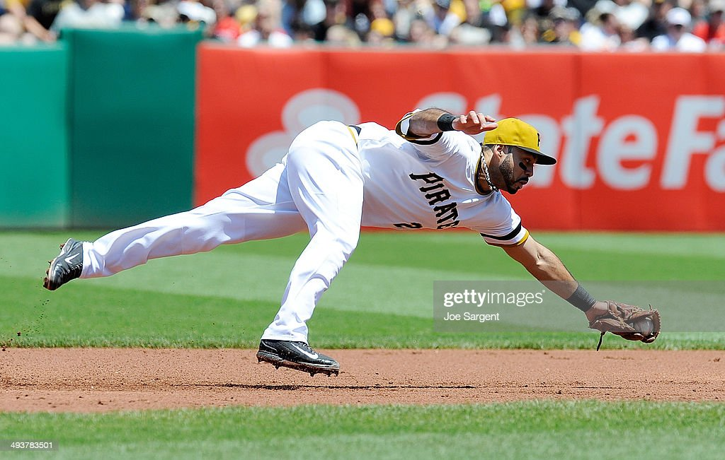 Pedro Alvarez #24 of the Pittsburgh Pirates makes a diving catch during the first inning against the Washington Nationals on May 25, 2014 at PNC Park in Pittsburgh, Pennsylvania.