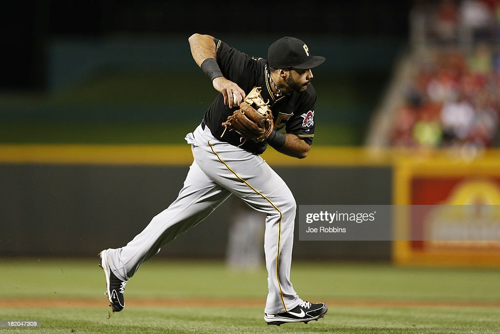 Pedro Alvarez #24 of the Pittsburgh Pirates makes a play at third base in the second inning against the Cincinnati Reds during the game at Great American Ball Park on September 27, 2013 in Cincinnati, Ohio.
