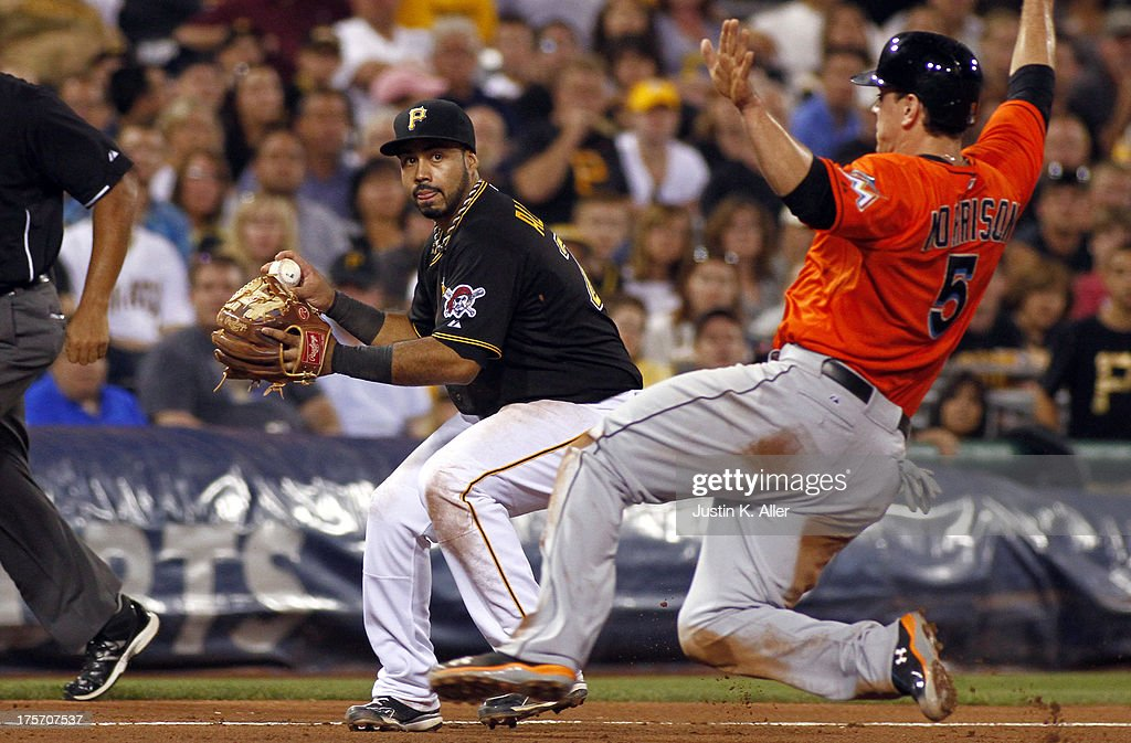 Pedro Alvarez #24 of the Pittsburgh Pirates makes a throwing error in the seventh inning against the Miami Marlins during the game on August 6, 2013 at PNC Park in Pittsburgh, Pennsylvania.