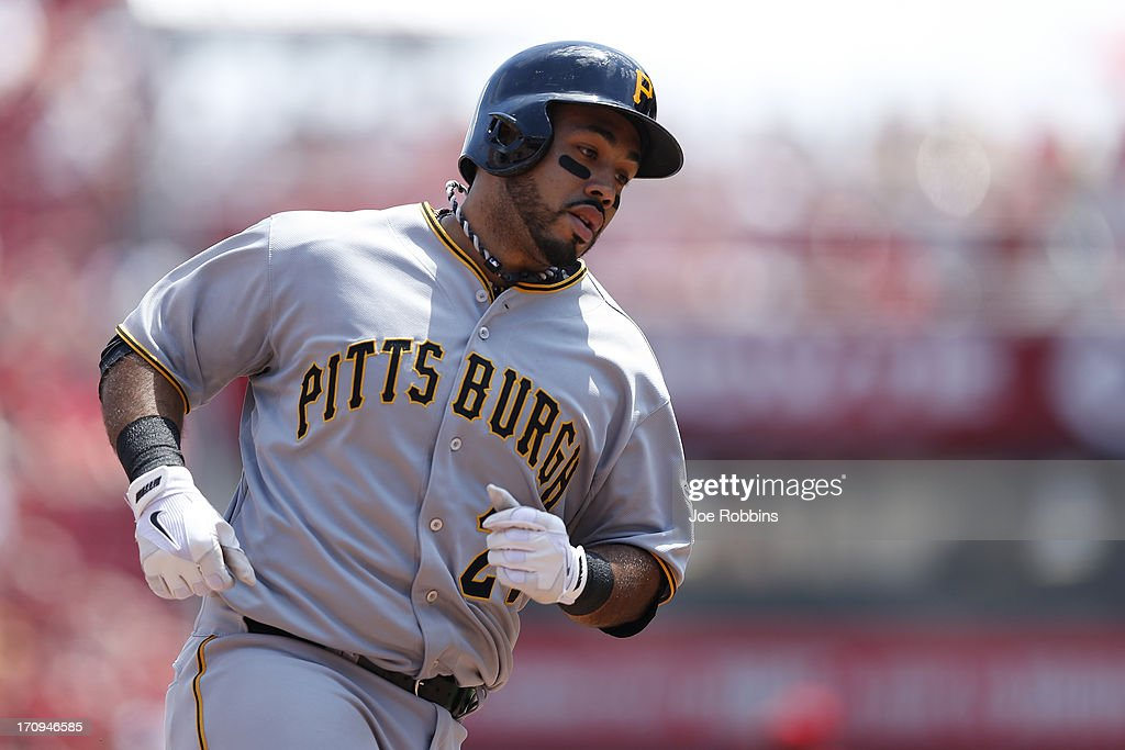 Pedro Alvarez #24 of the Pittsburgh Pirates rounds the bases after hitting a home run in the sixth inning against the Cincinnati Reds during the game at Great American Ball Park on June 20, 2013 in Cincinnati, Ohio. The Pirates won 5-3.