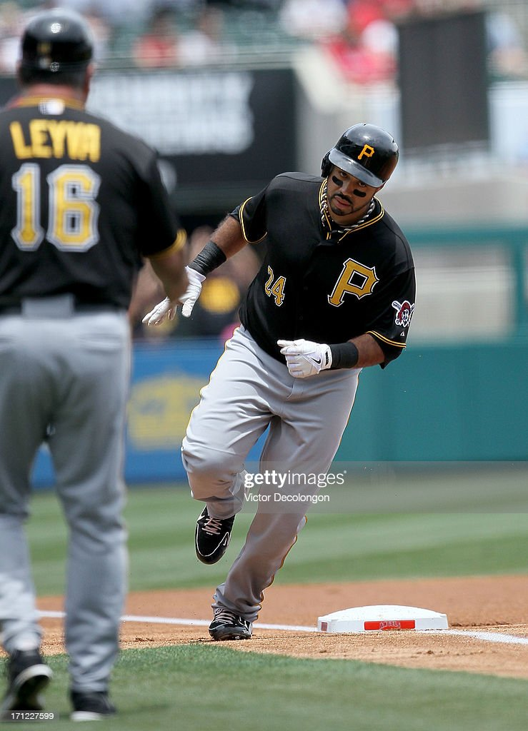 Pedro Alvarez #24 of the Pittsburgh Pirates rounds third base after hitting a solo homerun in the first inning during the MLB game against the Los Angeles Angels of Anaheim at Angel Stadium of Anaheim on June 23, 2013 in Anaheim, California.