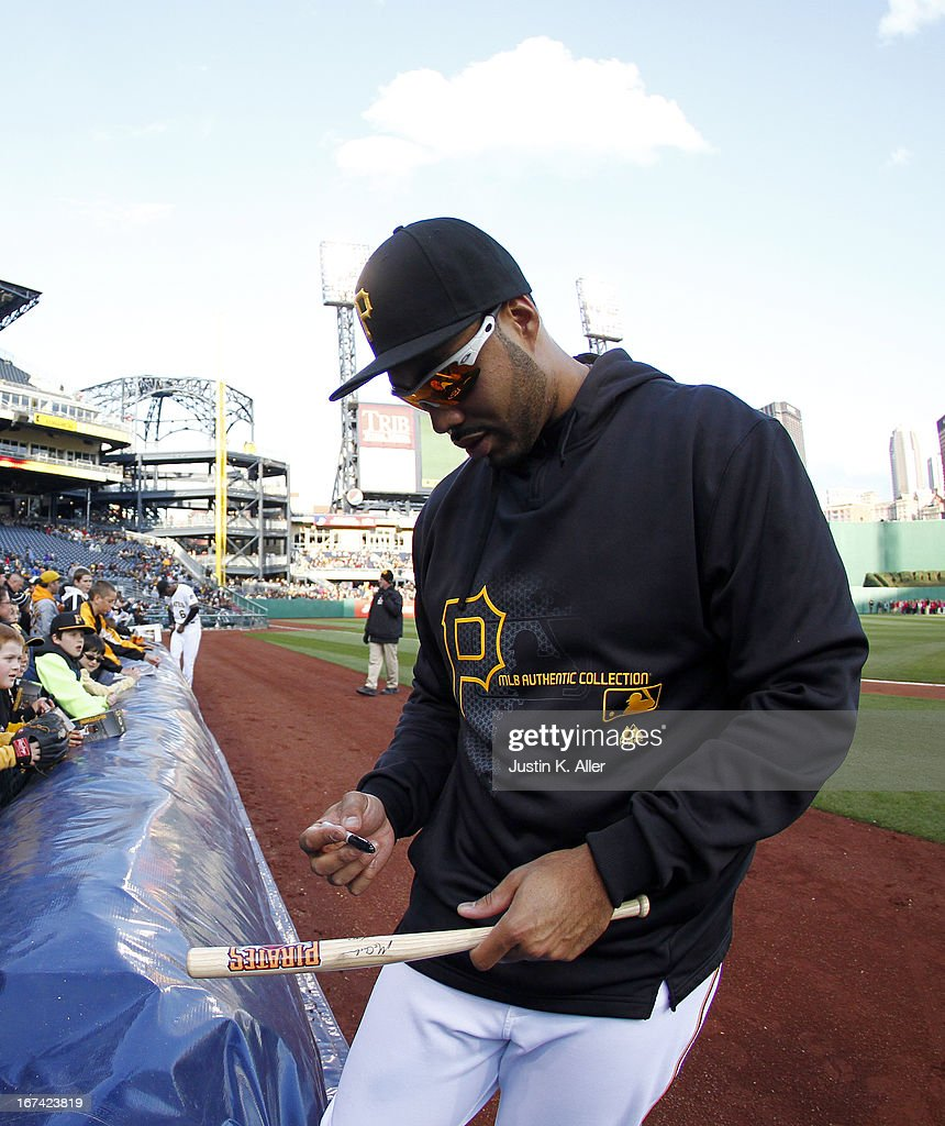 Pedro Alvarez #24 of the Pittsburgh Pirates signs autographs before the game against the Atlanta Braves on April 20, 2013 at PNC Park in Pittsburgh, Pennsylvania.