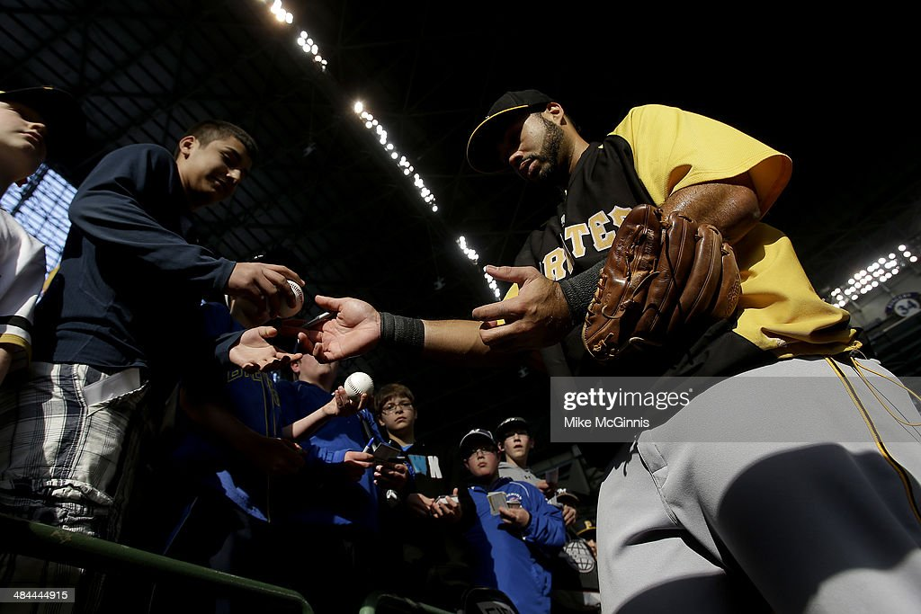 Pedro Alvarez #24 of the Pittsburgh Pirates signs some autographs before the start of the game against the Milwaukee Brewers at Miller Park on April 12, 2014 in Milwaukee, Wisconsin.